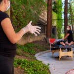 K2S employees performing stretch therapy outdoors