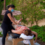 K2S employee performing stretch therapy outdoors