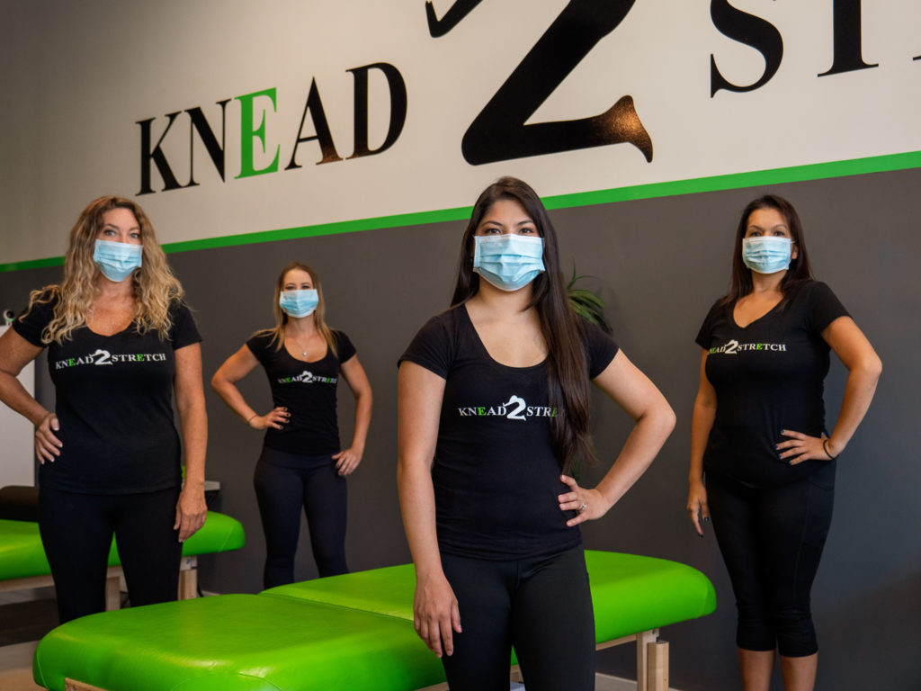 K2S therapists posing while wearing facemasks